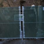 6_ H Chain Link Dumpster Enclosure With Green Privacy Slats