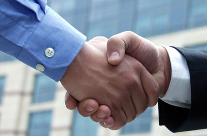 Venture Capital broker shaking hands with company executive