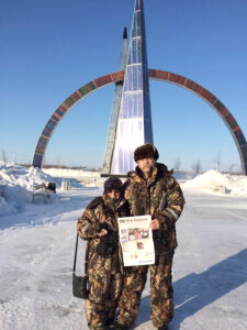 Fredda Cole (Stow) and Russ Fitch at the Arctic Circle in Salekhard, Russia at the conclusion of the their February motorcycle ride through Siberia.