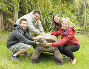 Vannasse and fellow research students pose with one of the Royal Melbourne Zoo's slower-paced residents.                                                   Courtesy