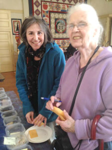 Reya Stevens (l) and Ruth Regan look over  seed samples                            Courtesy Nancy Arsenault