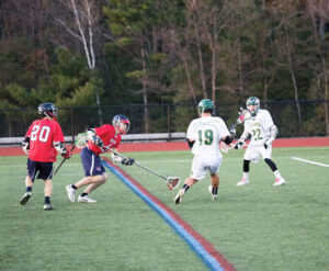 Nashoba's Drew Korn (#19) and Hunter Boudreau (#22) on the field against North Middlesex                                               Adrian Flatgard;  frequentflyerphotographer@gmail.com
