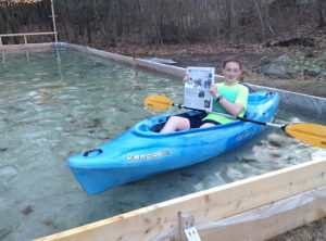 Cam Donahue took advantage of the family's melted ice rink to do some backyard kayaking.