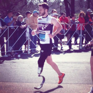 Cameron Kerr running his second complete Boston Marathon this April. This year he ran with the Achille Freedom Team.                                                                                Courtesy