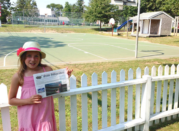Kathryn Lamont vacationing in Brewster MA, Cape Cod.  Kathryn is the daughter of George Lamont and she is holding the July 23 Stow Independent in which she  appeared on the front page at Fenway Park with her father.