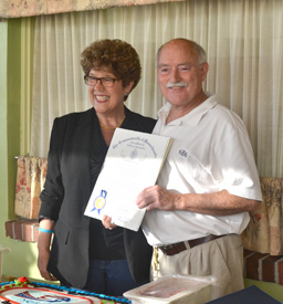 State Rep. Kate Hogan presents Don McPherson with a citation lauding Minute Man Air Field's 45 years of boosting business and community around Stow.  Jeff Needle Photo
