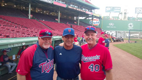 Stow's Paul Cacciatore (center) with former teammates Minnesota Twins manager Ron Gardenhire and pitching coach Rick Anderson,  at a recent game at Fenway Park.                                                                                                                                          Courtesy