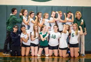 The Nashoba Varsity Girls Volleyball team with team managers Max Sharin and Nathan Kovacs, and  coach Johnna Doyle.                                                                   Adrian Flatgard; www.frequentflyerphotographer@gmail.com