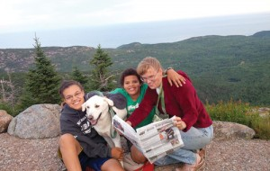 """The Farris family took a camping trip to Acadia National Park in Maine.   Pictured  on the top of Cadillac Mountain are Anne, Kenny and Amy Farris, with their dog Stanley.  Amy wrote, """"Soon after the photo was taken we watched a beautiful sunset. We had a great trip. The kids had a great time clamboring over the rocks.  Stanley enjoyed going everywhere with us, including on the shuttle bus and in the stores in Bar Harbor."""""""