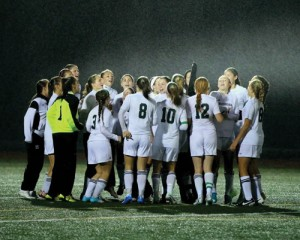The Girls Varsity soccer team in a rain-soaked victory Thursday night.  Susan Shaye; www.susanshaye.com