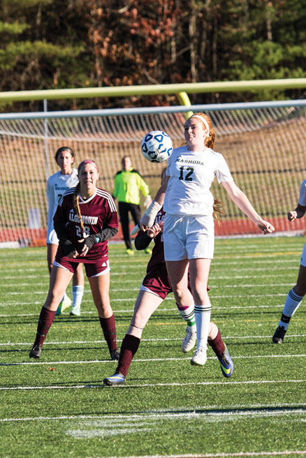 Stow's Kiley Lance (#12) with Julia Hill (#9).                                                                        Adrian Flatgard; frequentflyerphotographer@gmail.com