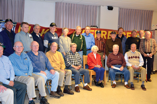 Pictured above with Janice Reidy are some of Stow's veterans representing conflicts as far back as World War II and including several branches of the military.                                                            Courtesy Richard Simon, President Rotary Club of Nashoba Valley