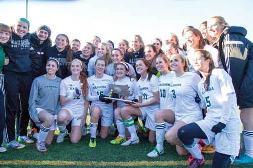 The Nashoba Girls Soccer team lifted the District Championship Trophy on Saturday with a 1-0 victory over Algonquin Regional.                    The team moved on to the state semi-finals on Tuesday, but lost in the last minutes of the game with a final score of 1-0.                                         Adrian Flatgard; frequentflyerphotographer@gmail.com