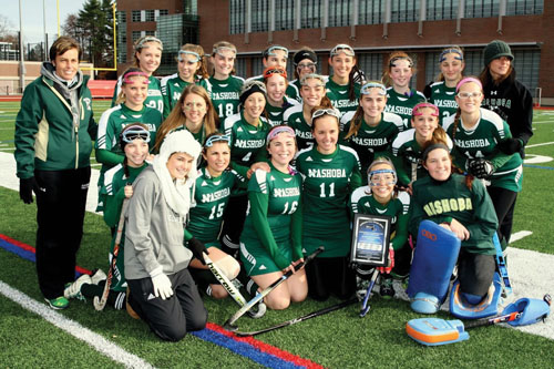 Before the start of Sunday's game, the Nashoba Field Hockey team was presented with the MIAA Sportsmanship Award.  They were selected by the MIAA Field Hockey Committee. The team i spictured above with their award. Below: Stow senior captain #5 Emma Caviness up against #7 Leah Cardarelli from Acton-Boxborough.                                           Susan Shaye; www.susanshaye.com