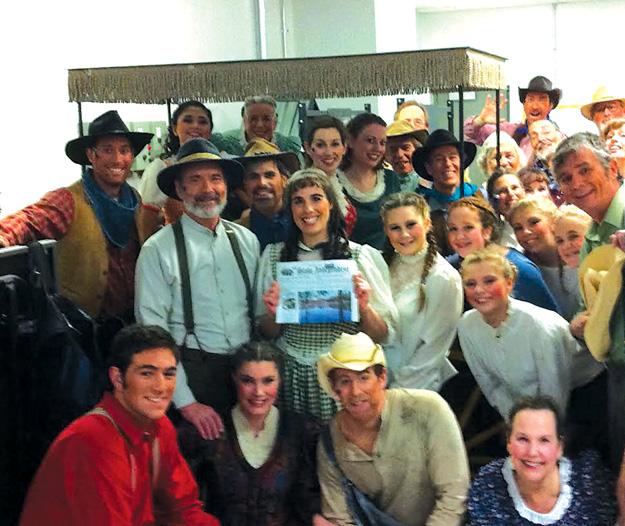 Debbie Crane (holding the paper ) with many of her cast mates from The Savoyard Light Opera Company's production of Rodger and Hammersteins Oklahoma in Carlisle.