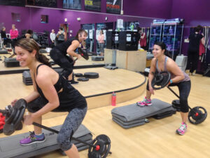 Kimberly Saart (l) and  Kim O'Brien warm up before the Power class at Global Fitness.                                                                                                 Nancy Arsenault