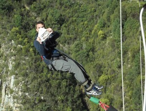 Frank Smith tries to read after leaping from Bloukrans Bridge on the border of the Eastern and Western Cape, during a road trip across the southern coast of South Africa. The jump is run by Face Adrenalin, and is the third highest commercial bungee jump in the world, at 216 metres.