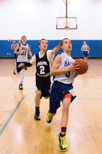 Andrew Ahlquist (#3) is first down the floor for a layup.                               Adrian Flatgard