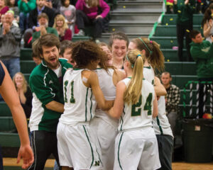 The undefeated girls basketball team is on their way to the Division 2 playoffs on Wednesday night. Pictured at right, they celebrate teammate Erin Cressman's 1000th career point.  Susan Shaye; susanshaye.com