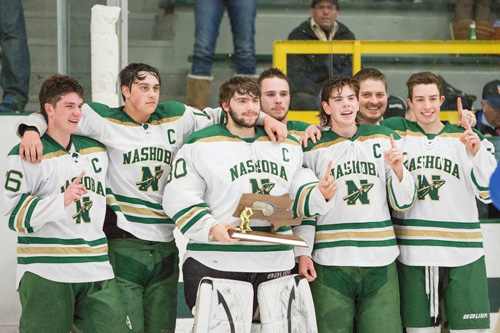 On Monday night, Nashoba hockey won the Division Championship for the first time since 1980. Pictured with the  CMass Div. 3A Championship trophy are: (L-R)  #16 Jack Charbonneau (Senior, Captain), #10 Brad Colvin (Junior, Captain), #30 Luke Gilchrest (Senior, Captain), #9 Kevin Gilchrest (Senior, Captain), #21 Hunter Boudreau (Senior, Captain), Head Coach Trevor Short, and #26 P.J. Anastas (Senior, Captain).                                                                                                                                                        Susan Shaye; susanshaye.com