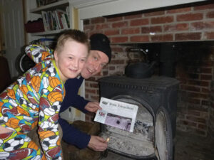 The Coppes family stayed home for school vacation :( and used the Stow Independent to start a fire to keep warm!  Pictured:  Peter Coppes and David Coppes