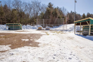 Several weeks ago, co-captain Sarah Gaffney reported that Bill Tuttle, Dan Gaffney, and Jack Gaffney worked for a total of 12 hours over two days to plow off the softball field at Nashoba to give the melting and drying out process a head start.                                                              Susan Shaye; www.susanshaye.com