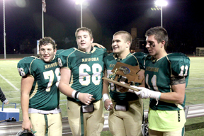 Pictured (l-r) with the Div. 2 Trophy: Will Phaneuf, BobbyDenaro, Mike Curtin, Egan Bachtell. The team will play at Gillette Stadium in the State Finals Saturday, Dec. 5.                                                                                Courtesy Eric Bachtell