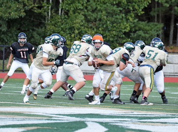 The Nashoba Chieftains football team are poised to start the new season next Friday night,after bringing home the Division Superbowl trophy last season. This year, quarterback duties fall to Owen Fay, pictured above. Story below.                                                                                                                                                                       SusanShaye.com