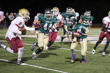 Kyle Hume (#44) and Breese Hill (#15). The purple accessories                                                  represent support for Pancreatic Cancer Awareness in honor of the passing of Cheryl Wood, mother of Nashoba students Sophie and Jack (who is on the football team), and wife of former Nashoba superintendent Michaei Wood.    SusanShaye.com