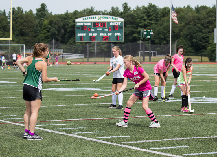 At the Nashoba High School Field Hockey clinic held Aug. 14 - 16, the Varsity and JV Field Hockey team took on the role of mentors/teachers to the younger clinic participants. The clinic was overseen by Nashoba Varsity  Head Coach Jaime Mariani and JV Coach Ashley Wing. Pictured above,  Varsity player Mckenna Hannigan works on stick handling skills.  SusanShaye.com