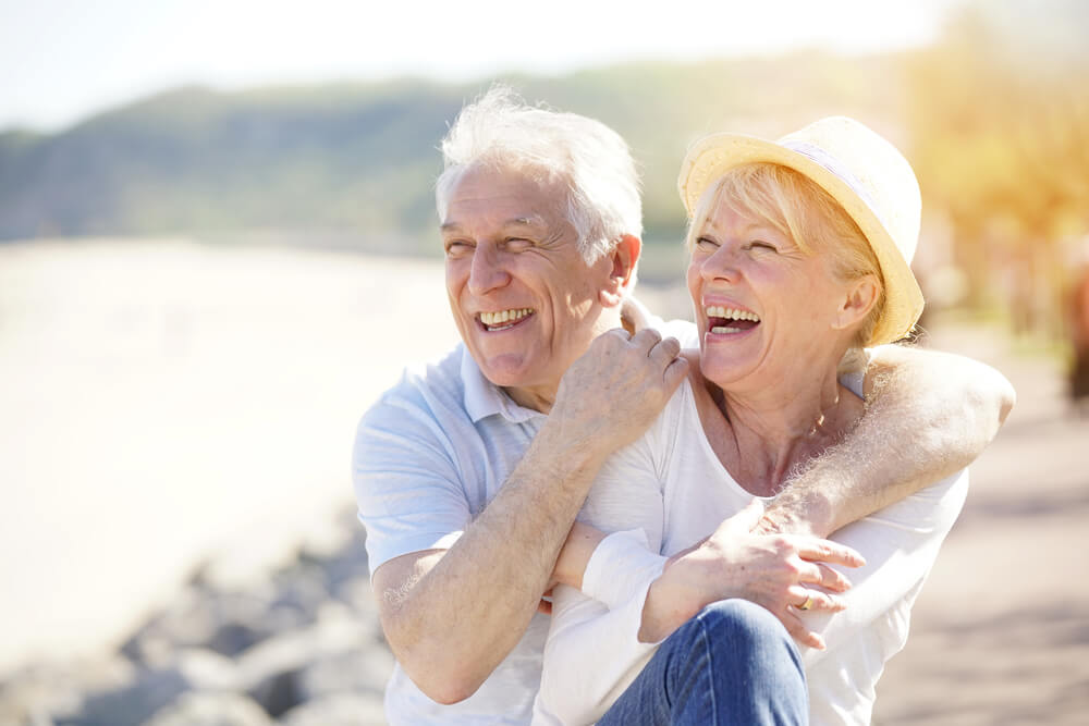 Happy Retired Couple on the Beach