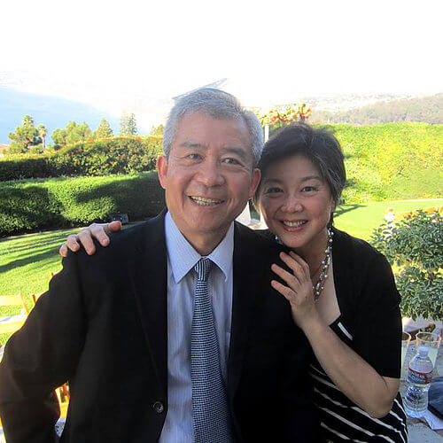 Picture of an older couple outside by a wine vineyard