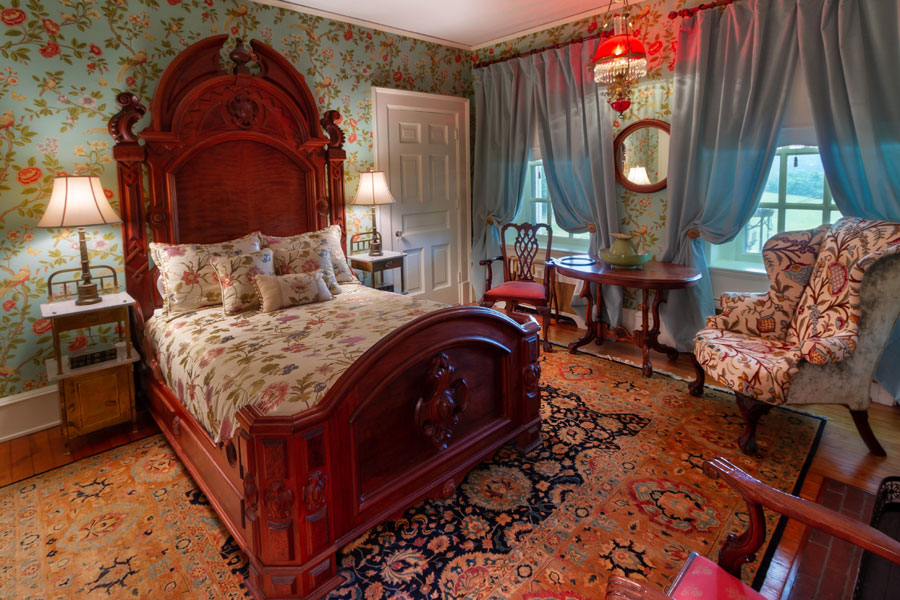gunston guestroom with antique decor at the inn at forest oaks in natural bridge virginia