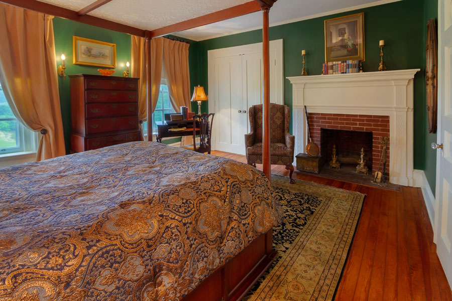 milburne room bed dresser and fireplace at the inn at forest oaks in natural bridge virginia
