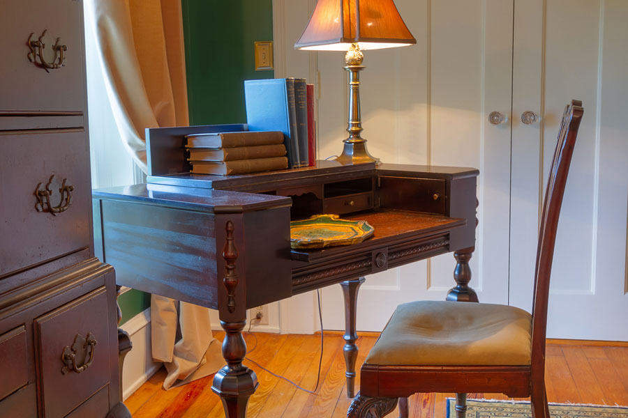 milburn room antique writing desk and chair at the inn at forest oaks in natural bridge virginia