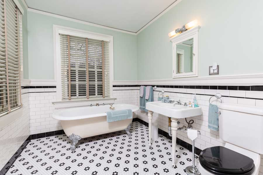 outlands bathroom with pedestal sink and clawfoot tub at the inn at forest oaks in natural bride, virginia