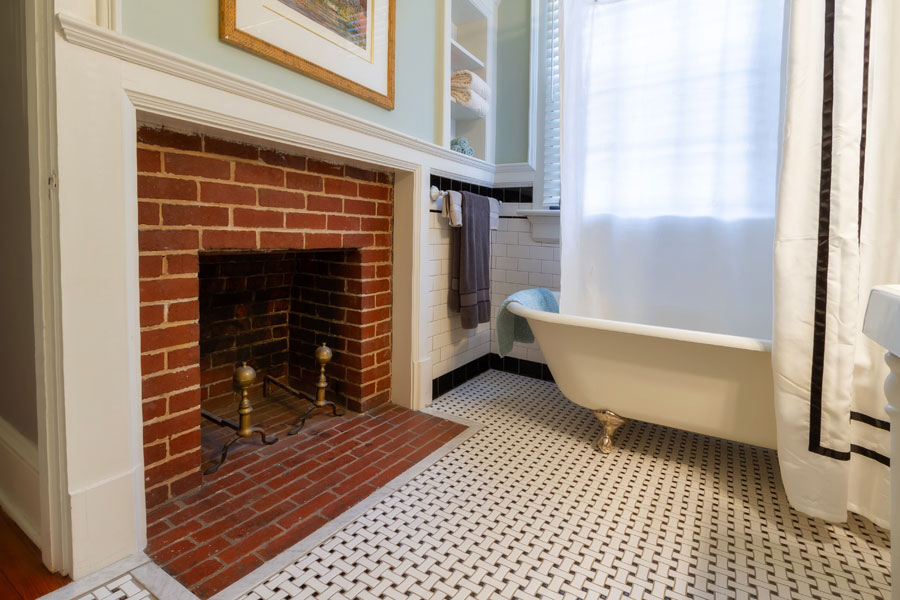 stratford guestroom bathroom with fireplace and clawfoot tub at the inn at forest oaks in natural bridge virginia