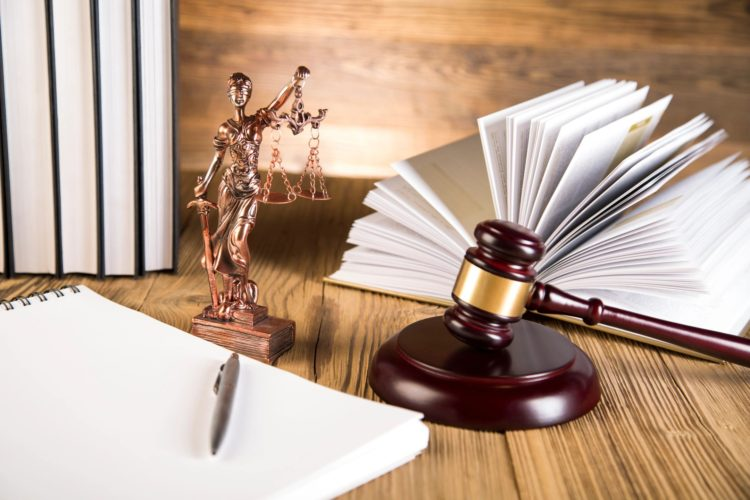 Legal book and document with scales of justice and gavel