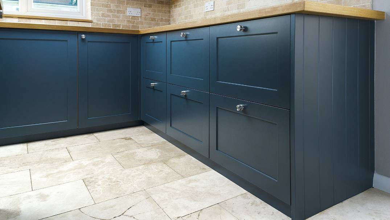 custom blue shaker base cabinets