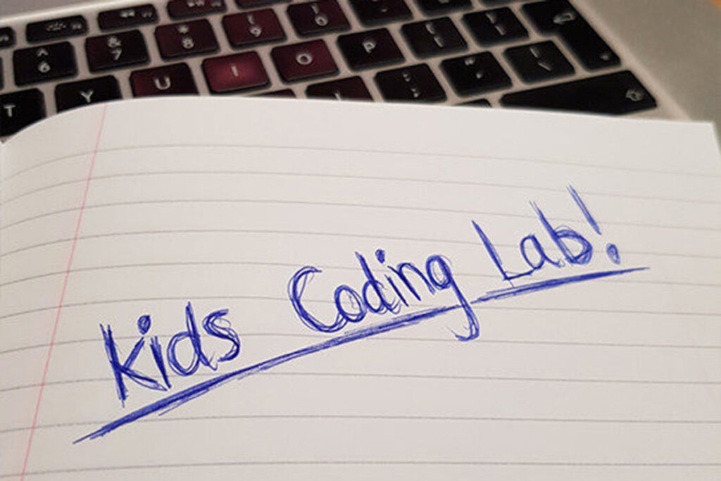 Image of kids coding written in notebook