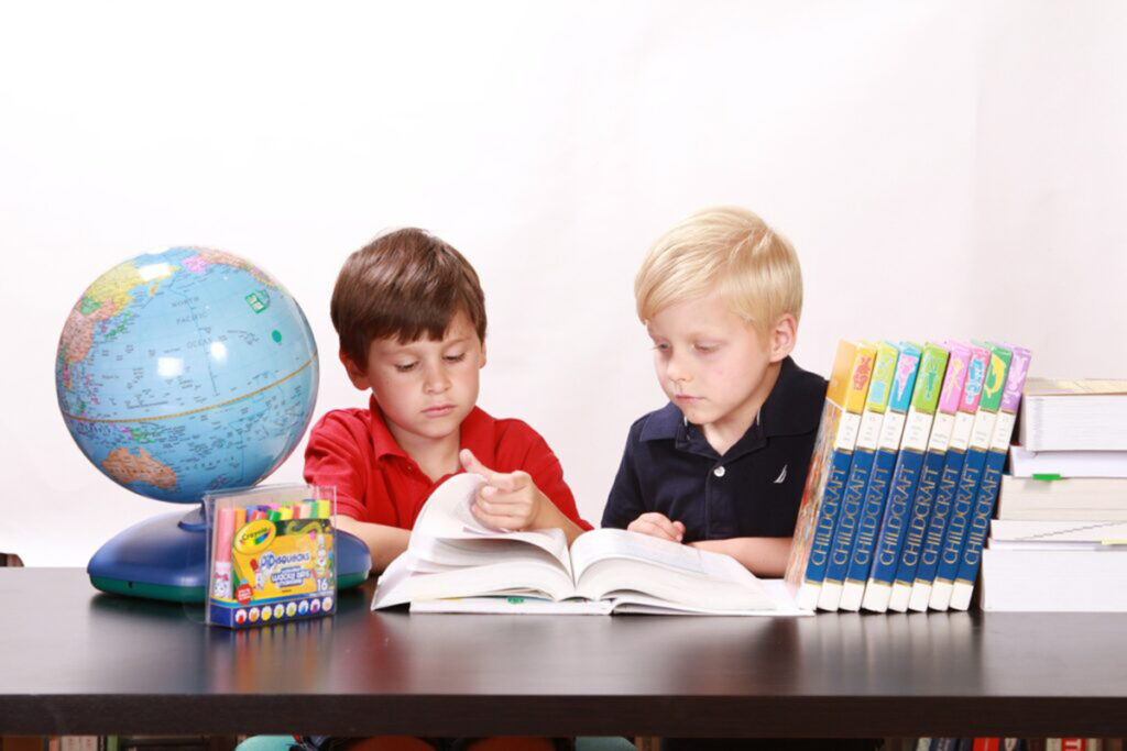 Image of two kids studying for sats.
