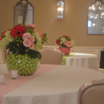 setting up tables pink and green flowers
