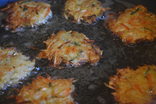 Latkes frying on a pan