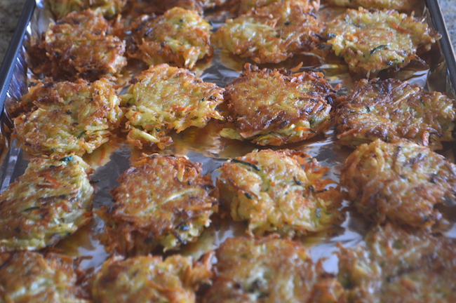 Latkes on a baking sheet to freeze