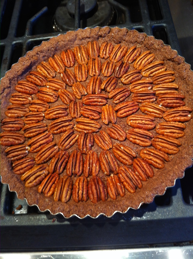 Make a design with the pecans for the Chocolate Pecan Tart