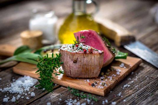 Medium Rare Steak Resting on Cutting Board