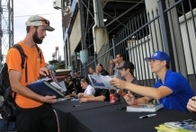 Todd handing out autograph