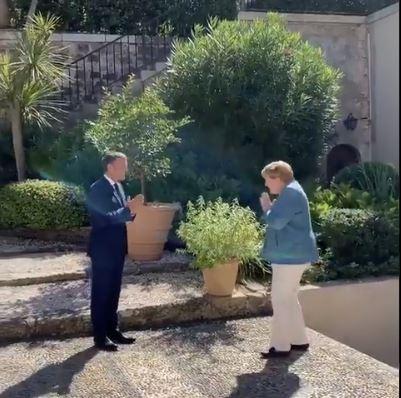 Emmanuel Macron Angela Merkel Namaste