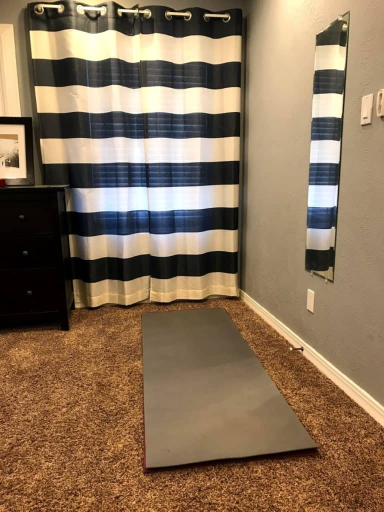 rolled out yoga mat in bedroom