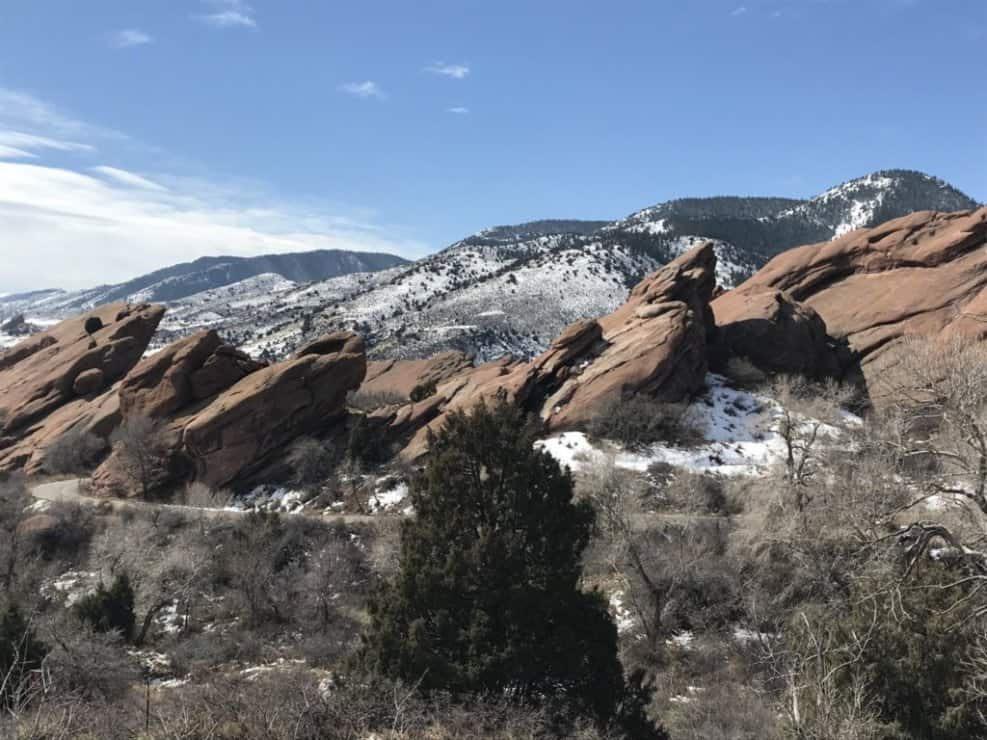 Red rock stack Colorado with snow covered mountains in the background